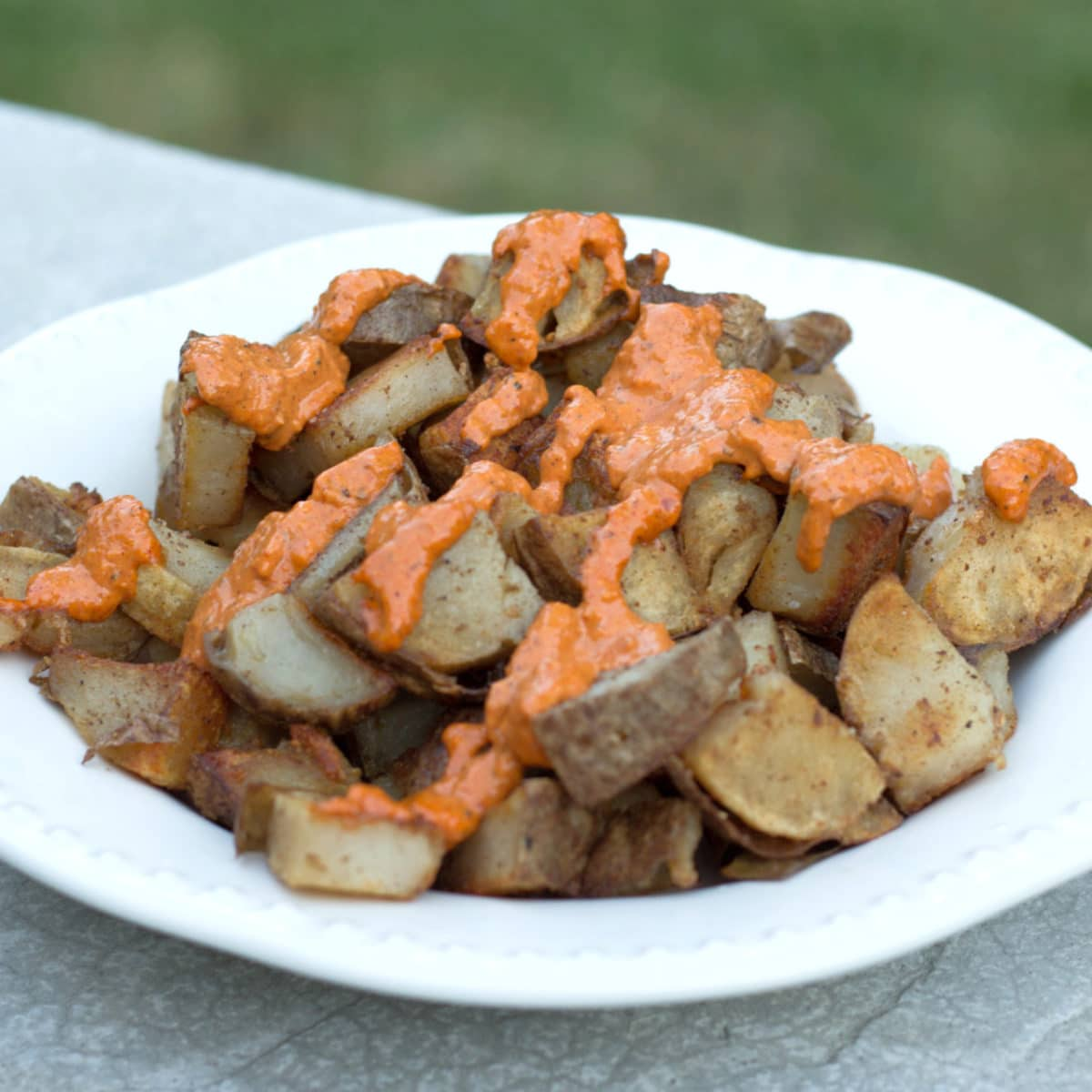 Want an authentic taste of Spain? Make these amazing patatas bravas. Potatoes with a beautiful spicy paprika sauce.